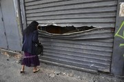 عکس روز |  مغازه غارتشده