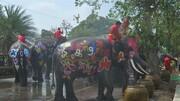 عکس | مراسم آب بازی با فیلها در تایلند