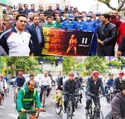 رکاب زنی حناچی با جمعی از کارگران شهرداری تهران در سهشنبههای بدون خودرو