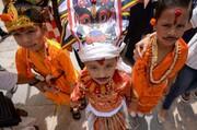 عکس روز: کودکان در جشنواره گاو