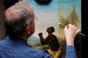 مرمت یک تابلو برای مبارزه با بردهداری