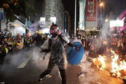 هنگکنگ در آتش و گلوله و آب