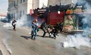 عکس روز: گریز از گاز اشکآور
