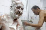 تصاویر | حمامکردن به شیوه ۱۰۰ سال پیش در قلب تهران
