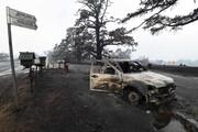 عکس روز | ماشین سوخته در جاده سوخته