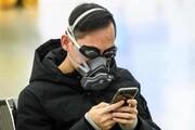 عکس روز| با عینک شنا و ماسک در برابر کورونا