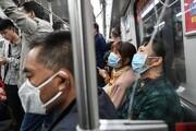 فیلم | مرد بدون ماسک در چین از مترو بیرون کشیده میشود