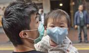 عکس | مبارزه پدر و پسر هنگکنگی با ویروس کرونا