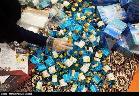 تصاویر بسته بندی و توزیع ۵۰ هزار بسته بهداشتی-قم