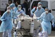 عکس روز | انتقال بیمار مبتلا به کرونا