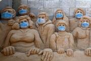 عکس روز | مجسمههای ماسکدار
