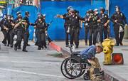 عکس | شلیک مستقیم پلیس به شهروند معلول و بیخانمان آمریکایی