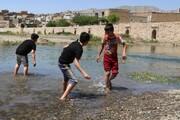 تصویر | آب بازی کودکان در پل قشلاق سنندج