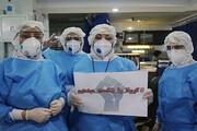 عکس | کادر درمان با لباسهای محافظتی در بازار علوی اهواز