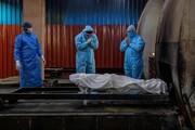 عکس روز| دعای پیش از مردهسوزان
