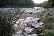 شکایت از تخلیه پسماند در بستر رودخانه تنگمان جم