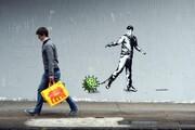 تصاویر | رد پای کرونا بر دیوارهای جهان