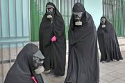 تدفین جنازه یک قربانی کرونا با ماسک شیمیایی