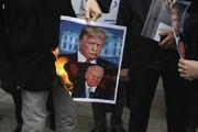 عکس روز| آتش زدن ترامپ و بایدن