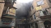 آتشسوزی در خیابان لالهزار تهران | ۱۶ نفر نجات پیدا کردند