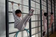تصاویر | مدرسه ژیمناستیک در چین | تمرینهای طاقت فرسا برای المپیک توکیو