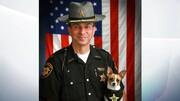 کوچکترین سگ پلیس جهان مرد