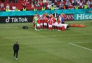عکس | ورود همسر و فرزند بازیکن بیهوش شده دانمارک به زمین بازی | ممانعت اشمایکل از نزدیک شدن به اریکسن