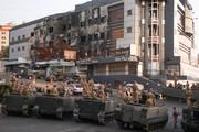 تصاویری از حمله افراد مسلح به مراسم تشییع نیروی حزبالله