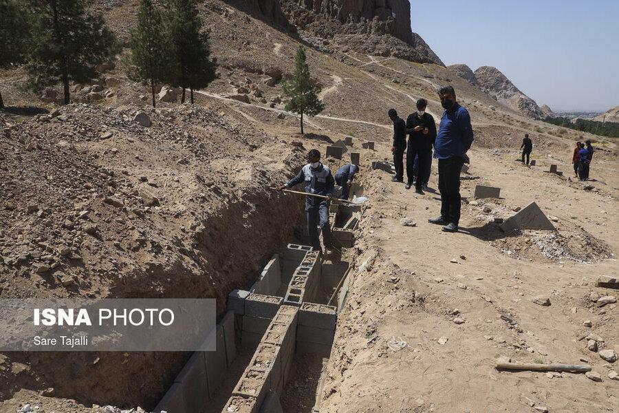 دفن جانباختگان کرونایی در کرمان ـ قطع درختان پارک جنگلی